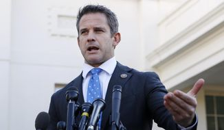 In this March 6, 2019 file photo, Rep. Adam Kinzinger, R-Ill., speaks to the media at the White House in Washington. (AP Photo/Jacquelyn Martin) ** FILE **