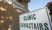 In this Aug. 21, 2019 file photo, a sign is displayed at Planned Parenthood of Utah in Salt Lake City. Senate Republicans have set up votes on two bills in the last week of February that would criminalize some abortion procedures after 20 weeks of pregnancy. The vote could put Democrats on the spot about how far they would go in supporting abortion rights. (AP Photo/Rick Bowmer)