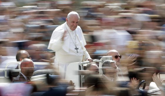 Pope Francis greets faithful after celebrating Mass on the occasion of the Migrant and Refugee World Day, in St. Peter's Square, at the Vatican, Sunday, Sept. 29, 2019. (AP Photo/Andrew Medichini)