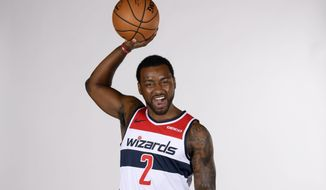 Washington Wizards' John Wall poses for a portrait during an NBA basketball media day, Monday, Sept. 30, 2019, in Washington. (AP Photo/Nick Wass) ** FILE **