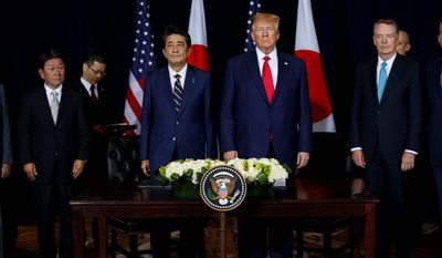 President Donald Trump stands with Japanese Prime Minister Shinzo Abe before signing an agreement on trade at the InterContinental Barclay New York hotel during the United Nations General Assembly, Wednesday, Sept. 25, 2019, in New York. From left, Japanese Foreign Minister Toshimitsu Motegi, Abe, Trump, and U.S. Trade Representative Robert Lighthizer. (AP Photo/Evan Vucci) ** FILE **