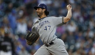 Milwaukee Brewers starting pitcher Gio Gonzalez (47) in the first inning of a baseball game Saturday, Sept. 28, 2019, in Denver. (AP Photo/David Zalubowski) ** FILE **
