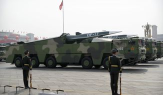 Chinese military vehicles carrying DF-17 ballistic missiles rolled through Beijing on Tuesday in a parade to commemorate the 70th anniversary of Communist Party power. (Associated Press)