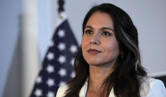 Democratic presidential candidate U.S. Rep. Tulsi Gabbard, D-Hawaii, listens to a question during a campaign stop in Londonderry, N.H., Tuesday, Oct. 1, 2019. (AP Photo/Charles Krupa) ** FILE **