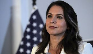 Democratic presidential candidate U.S. Rep. Tulsi Gabbard, D-Hawaii, listens to a question during a campaign stop in Londonderry, N.H., Tuesday, Oct. 1, 2019. (AP Photo/Charles Krupa)