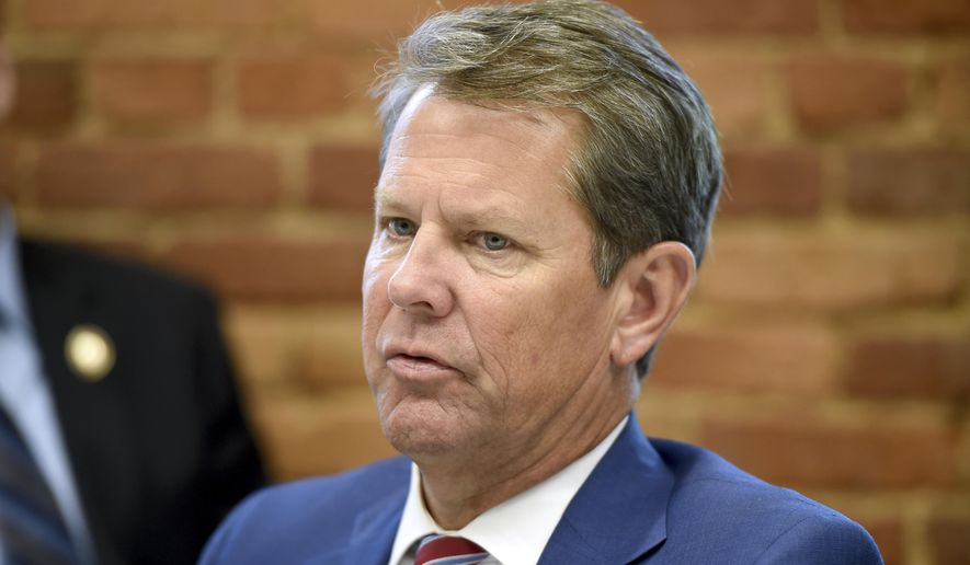 This July 2, 2019, file photo shows Georgia Republican Gov. Brian Kemp during a roundtable discussion on Georgia's health care challenges at Christ Community Health Center in Augusta, Ga. (Michael Holahan/The Augusta Chronicle via AP, File)
