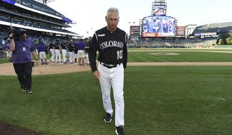 Colorado Rockies manager Bud Black (10) walks off the field after their win over the Milwaukee Brewers 4-3 in 13 innings at a baseball game Sunday, Sept. 29, 2019, in Denver. (AP Photo/John Leyba)