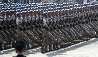 Chinese military personnel march during the parade to commemorate the 70th anniversary of the founding of Communist China in Beijing, Tuesday, Oct. 1, 2019. (AP Photo/Ng Han Guan)