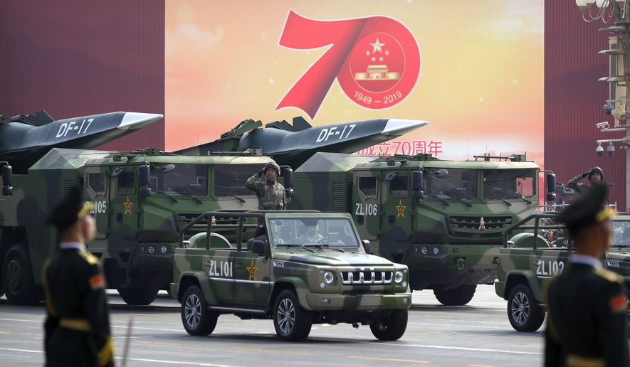 Chinese military vehicles carrying DF-17 ballistic missiles roll during a parade to commemorate the 70th anniversary of the founding of Communist China in Beijing, Tuesday, Oct. 1, 2019. Trucks carrying weapons including a nuclear-armed missile designed to evade U.S. defenses rumbled through Beijing as the Communist Party celebrated its 70th anniversary in power with a parade Tuesday that showcased China's ambition as a rising global force. (AP Photo/Mark Schiefelbein)
