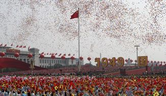 Balloons are released during the 70th anniversary of the founding of the People's Republic of China in Beijing on Tuesday, Oct. 1, 2019. (AP Photo/Ng Han Guan)
