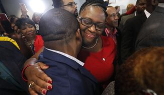Allison Jean, center, the mother of Botham Jean, hugs a supporter after fired Dallas police officer Amber Guyger was found guilty of murder, Tuesday, Oct. 1, 2019, in Dallas. Guyger shot and killed Botham Jean, an unarmed 26-year-old neighbor in his own apartment last year. She told police she thought his apartment was her own and that he was an intruder. (AP Photo/LM Otero)