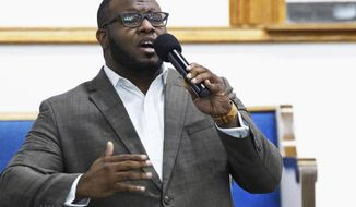 FILE - In this Sept. 21, 2017, file photo, provided by Harding University in Searcy, Ark., Botham Jean leads worship at a university presidential reception in Dallas. Fired Dallas police Officer Amber Guyger, who shot and killed Botham Jean, an unarmed 26-year-old neighbor in his own apartment last year, was found guilty of murder by a jury on Tuesday, Oct. 1, 2019. She told police she thought his apartment was her own and that he was an intruder.(Jeff Montgomery/Harding University via AP, File)