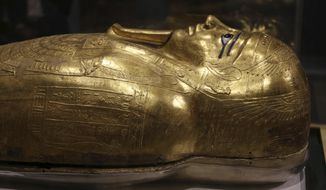 The golden coffin that once held the mummy of Nedjemankh, a priest in the Ptolemaic Period some 2,000 years ago, is displayed at the National Museum of Egyptian Civilization, in Old Cairo, Egypt, Tuesday, Oct. 1, 2019. Egypt is displaying the gilded ancient coffin returned to the country last week from New York's Metropolitan Museum of Art after U.S. investigators determined to be a looted antiquity. (AP Photo/Mahmoud Bakkar)