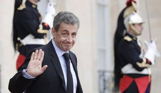 Former French President Nicolas Sarkozy leaves the Elysee Palace after a lunch with heads of states and officials, Monday, Sept. 30, 2019 in Paris. France bid a final adieu to former French President Jacques Chirac on Monday as he received military honors on a national day of mourning that culminated with a memorial service attended by dozens of past and current world leaders. (AP Photo/Kamil Zihnioglu)