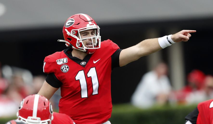 """FILE - In this Sept. 14, 2019, file photo, Georgia quarterback Jake Fromm (11) is shown In the first half of an NCAA college football game against Arkansas State, in Athens, Ga. Fromm says Jim Chaney, the Bulldogs' former offensive coordinator, """"really kind of introduced me to this pro-style offense."""" Now Chaney is running Tennessee's offense, and Fromm wants to show he learned his lessons well when the No. 3 Bulldogs face the Vols on Saturday. (AP Photo/John Bazemore, File)"""
