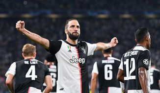 Juventus' Gonzalo Higuain celebrates after scoring a goal during the UEFA Champions League group D soccer match against Bayer Leverkusen at the Allianz Stadium in Turin, Italy, Tuesday, Oct. 2019. (Alessandro Di Marco/ANSA via AP)