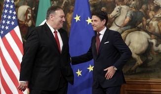 Italian Premier Giuseppe Conte, right, meets U.S. Secretary of State, Mike Pompeo, at Chigi Palace premier's office in Rome, Tuesday, Oct. 1, 2019. 2019. U.S. Secretary of State Mike Pompeo is in Italy at the start of a four-nation tour of Europe as the push to impeach President Donald Trump gains steam at home. (AP Photo/Andrew Medichini)