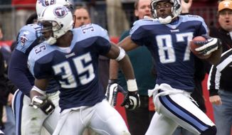 FILE - In this Jan. 8, 2000, file photo, Tennessee Titans wide receiver Kevin Dyson (87) looks back as he returns a kickoff in the fourth quarter during an AFC wild card football game in Nashville, Tenn. Blocking for Dyson are Perry Phenix (35) and Greg Favors (51). Dyson sped 75 yards down the left sideline with a lateral from Frank Wycheck on a kickoff for the winning touchdown with 3 seconds remaining, lifting the Tennessee Titans to a 22-16 playoff victory over the stunned Buffalo Bills. (AP Photo/Wade Payne, File)