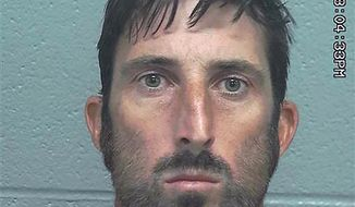 This photo provided by the Midland County Sheriff's Office shows Troy Lee Wilson. Wilson has been arrested after authorities say he killed one person and injured another when he opened fire several times last week on people whose vehicles stalled in the Odessa area of West Texas. Wilson of Odessa was arrested and charged Friday, Sept. 27, 2019, with murder and evading arrest. The 36-year-old remained jailed Tuesday on $550,000 bond. An affidavit says that in four incidents last week Wilson shot at people after offering to help with their vehicles. (Midland County Sheriff's Office via AP)