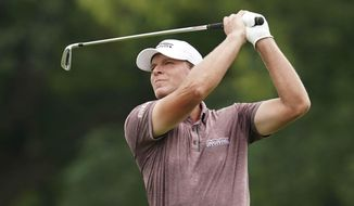 FILE - In this Sunday, July 15, 2018 file photo, Steve Stricker hits on the ninth fairway during the final round of the John Deere Classic golf tournament at TPC Deere Run in Silvis, Ill. Steve Stricker and Padraig Harrington were at Whistling Straits in Sheboygan, Wis., on Tuesday, Oct. 1, 2019 to talk about the Ryder Cup one year before the matches are played.(AP Photo/Charlie Neibergall), File
