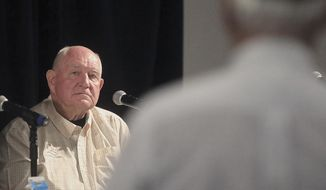 U.S. Secretary of Agriculture Sonny Perdue listens to a question from a Wisconsin farmer during a town hall meeting at the World Dairy Expo in Madison, Wis. Tuesday, Oct. 1, 2019. (John Hart/Wisconsin State Journal via AP)