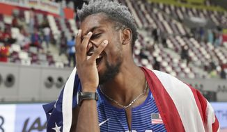 Noah Lyles, of the United States, celebrates after winning the men's 200 meters at the World Athletics Championships in Doha, Qatar, Tuesday, Oct. 1, 2019. (AP Photo/Hassan Ammar)