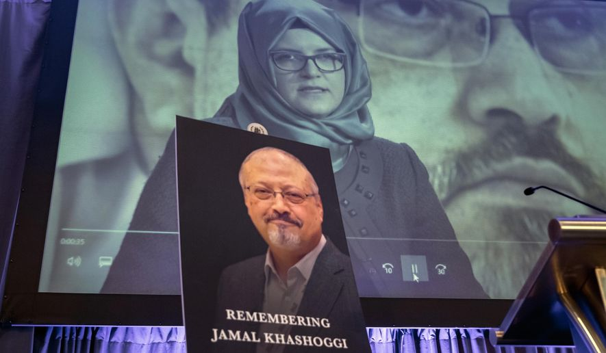 FILE - In this Nov. 2, 2018 file photo, a video image of Hatice Cengiz, fiancee of slain Saudi journalist Jamal Khashoggi, is played during an event to remember Khashoggi, who died inside the Saudi Consulate in Istanbul on Oct. 2, 2018, in Washington. The killing of Washington Post columnist Jamal Khashoggi at the Saudi Consulate in Istanbul drew renewed scrutiny to the kingdom, as his son and a U.N. investigator spoke out Tuesday, Oct. 1, 2019, ahead of the anniversary of his death. (AP Photo/J. Scott Applewhite, File)
