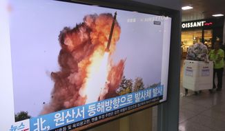 "A TV screen shows a file image of a North Korea's missile launch during a news program at the Seoul Railway Station in Seoul, South Korea, Wednesday, Oct. 2, 2019. North Korea on Wednesday fired projectiles toward its eastern sea, South Korea's military said, in an apparent display of its expanding military capabilities ahead of planned nuclear negotiations with the United States this weekend. The sign reads: "" A projectile laugh from North Korea."" (AP Photo/Ahn Young-joon)"