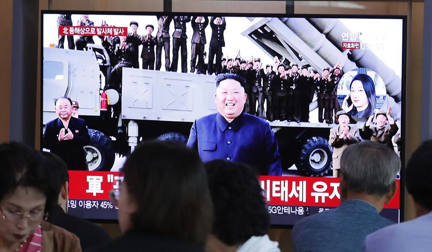 People watch a TV showing a file image of North Korean leader Kim Jong-un during a news program at the Seoul Railway Station in Seoul, South Korea, Wednesday, Oct. 2, 2019. North Korea on Wednesday fired projectiles toward its eastern sea, South Korea's military said, in an apparent display of its expanding military capabilities ahead of planned nuclear negotiations with the United States this weekend. (AP Photo/Ahn Young-joon)