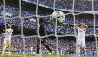 Real Madrid's Luka Modric, right, and Sergio Ramos, left, react after Brugge's Emmanuel Dennis scored his side's second goal during the Champions League group A soccer match between Real Madrid and Club Brugge, at the Santiago Bernabeu stadium in Madrid, Tuesday, Oct.1, 2019. (AP Photo/Manu Fernandez)