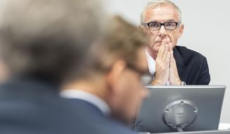 Urs Rohner, right, president of the board of Credit Suisse, speaks during a press conference of the Observation of Iqbal Khan in Zuerich, Switzerland, Tuesday, Oct. 1, 2019. (Ennio Leanza/Keystone via AP)