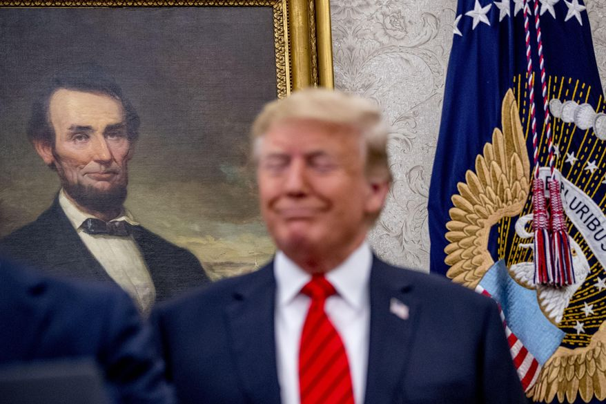 A painting of President Abraham Lincoln is seen behind President Donald Trump as he attends a ceremonial swearing in ceremony for new Labor Secretary Eugene Scalia in the Oval Office of the White House in Washington, Monday, Sept. 30, 2019. (AP Photo/Andrew Harnik)