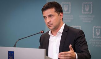 Ukrainian President Volodymyr Zelensky speaks to media during his press conference in Kyiv, Ukraine, Tuesday, Oct. 1, 2019. Ukraine on Tuesday signed much-anticipated accords with separatists from the country's east, Russia and European monitors that agree a local election can be held in separatist-controlled territory, paving the way for peace talks with Moscow. (Ukrainian Presidential Press Office via AP)