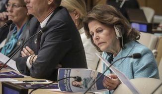 Queen Silvia of Sweden, founder of the World Childhood Foundation, review a report on child online safety from the Broadband Commission for Sustainable Development, during a high level meeting at the United Nations, Tuesday Oct. 1, 2019 at U.N. headquarters. (AP Photo/Bebeto Matthews)