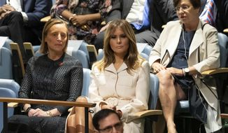 U.S. first lady Melania Trump listens as her husband, President Donald Trump, addresses the 74th session of the United Nations General Assembly at U.N. headquarters Tuesday, Sept. 24, 2019. (AP Photo/Mary Altaffer)