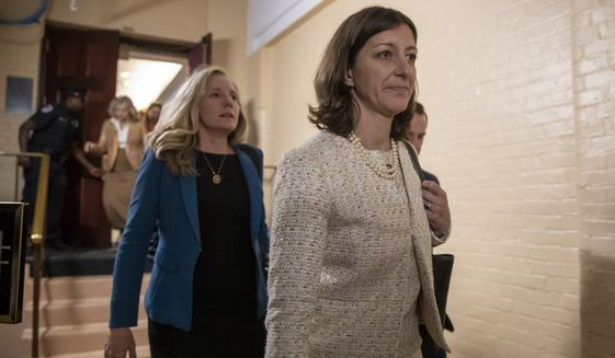 Rep. Elaine Luria, D-Va., right, followed by Rep. Abigail Spanberger, D-Va., left, leave a House Democratic Caucus meeting with Speaker of the House Nancy Pelosi, D-Calif., where she was persuaded to launch a formal impeachment inquiry against President Donald Trump, at the Capitol in Washington, Tuesday, Sept. 24, 2019. Rep. Luria and Rep. Spanberger are two of several freshmen Democrats with national security backgrounds who wrote an op-ed letter to the Washington Post calling for Trump's impeachment. (AP Photo/J. Scott Applewhite)