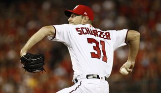 Washington Nationals starting pitcher Max Scherzer throws to the Milwaukee Brewers during a National League wild card baseball game, Tuesday, Oct. 1, 2019, in Washington. (AP Photo/Patrick Semansky)