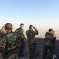 Kurdish peshmerga use binoculars to look for ISIS activity below Mount Qarachogh. (Seth J. Frantzman - Special to The Washington Times)
