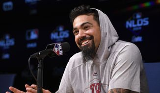 Washington Nationals third baseman Anthony Rendon answers a question during a news conference prior to practice for Game 1 of the NLDS baseball game against the Los Angeles Dodgers Wednesday, Oct. 2, 2019, in Los Angeles. (AP Photo/Mark J. Terrill)
