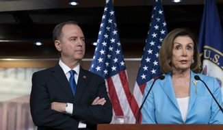 Speaker of the House Nancy Pelosi, D-Calif., is joined by House Intelligence Committee Chairman Adam Schiff, D-Calif., at a news conference as House Democrats move ahead in the impeachment inquiry of President Donald Trump, at the Capitol in Washington, Wednesday, Oct. 2, 2019. In an unusual show of anger today, Trump defended his phone call with the president of Ukraine and said Adam Schiff may have committed treason by investigating the matter. (AP Photo/J. Scott Applewhite)