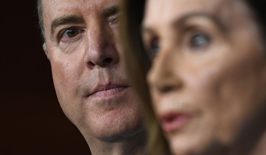 House Intelligence Committee Chairman Rep. Adam Schiff, D-Calif., left, listens as House Speaker Nancy Pelosi of Calif., right, speaks during a news conference on Capitol Hill in Washington, Wednesday, Oct. 2, 2019 (AP Photo/Susan Walsh)