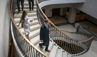House Intelligence Committee Chairman Adam Schiff, D-Calif., descends the stairs on the way to a secure room at the Capitol following a news conference with Speaker of the House Nancy Pelosi, D-Calif., as House Democrats move ahead in the impeachment inquiry of President Donald Trump, in Washington, Wednesday, Oct. 2, 2019. (AP Photo/J. Scott Applewhite)