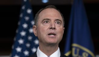 House Intelligence Committee Chairman Adam Schiff, D-Calif., listens at a news conference with Speaker of the House Nancy Pelosi, D-Calif., as House Democrats move ahead in the impeachment inquiry of President Donald Trump, at the Capitol in Washington, Wednesday, Oct. 2, 2019. In an unusual show of anger today, President Donald Trump defended his phone call with the president of Ukraine and said Adam Schiff may have committed treason by investigating the matter. (AP Photo/J. Scott Applewhite)