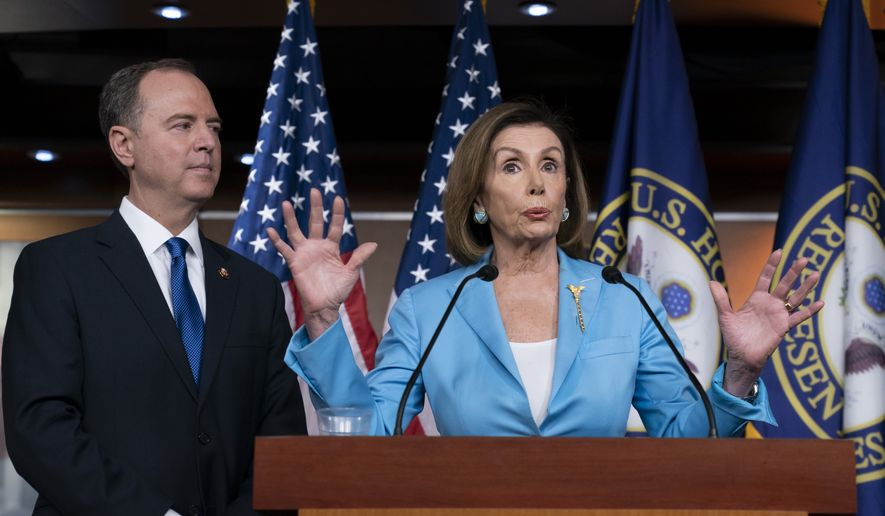 Speaker of the House Nancy Pelosi, D-Calif., is joined by House Intelligence Committee Chairman Adam Schiff, D-Calif., at a news conference as House Democrats move ahead in the impeachment inquiry of President Donald Trump, at the Capitol in Washington, Wednesday, Oct. 2, 2019. (AP Photo/J. Scott Applewhite) **FILE***