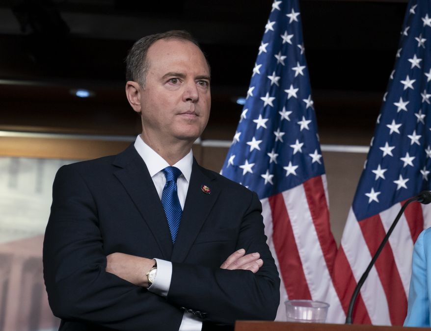 House Intelligence Committee Chairman Adam Schiff, D-Calif., listens at a news conference as House Democrats move ahead in the impeachment inquiry of President Donald Trump, at the Capitol in Washington, Wednesday, Oct. 2, 2019. In an unusual show of anger today, President Donald Trump defended his phone call with the president of Ukraine and said Adam Schiff may have committed treason by investigating the matter. (AP Photo/J. Scott Applewhite)