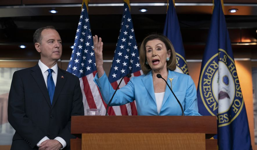 Speaker of the House Nancy Pelosi, D-Calif., is joined by House Intelligence Committee Chairman Adam Schiff, D-Calif., at a news conference as House Democrats move ahead in the impeachment inquiry of President Donald Trump, at the Capitol in Washington, Wednesday, Oct. 2, 2019. (AP Photo/J. Scott Applewhite) ** FILE **