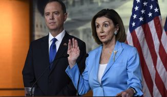 House Speaker Nancy Pelosi of Calif., joined by House Intelligence Committee Chairman Rep. Adam Schiff, D-Calif., speaks during a news conference on Capitol Hill in Washington, Wednesday, Oct. 2, 2019 (AP Photo/Susan Walsh)