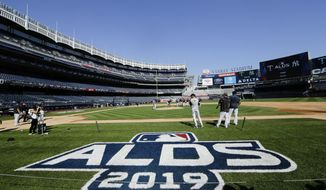 New York Yankees players warm up before a baseball team workout Wednesday, Oct. 2, 2019, at Yankee Stadium in New York. Yankees will host the Minnesota Twins in the first game of an American League Division Series on Friday. (AP Photo/Frank Franklin II)