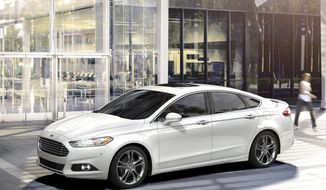 This undated photo provided by Ford Motor Co. shows the 2016 Ford Fusion. Some notable features in higher trims of the vehicle are more powerful 2.0-liter engine, keyless ignition and entry, remote start and a premium 12-speaker sound system. (Ford Motor Co. via AP)