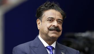 In this Sept. 24, 2017 file photo, Jacksonville Jaguars owner Shahid Khan stands before an NFL football game against between the Jaguars and the Baltimore Ravens at Wembley Stadium in London. Khan announced Wednesday, Oct. 2, 2019, that he is a majority investor in the nation's only 24-hour news network aimed at African American viewers. The network is to begin broadcasting in November and will be based in Tallahassee, Florida's capital, with bureaus around the country. (AP Photo/Matt Dunham, File)